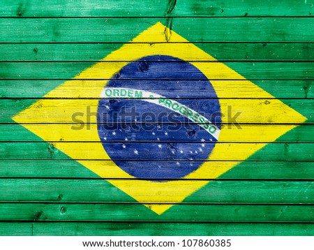 The Brazilian flag painted on wooden fence - stock photo