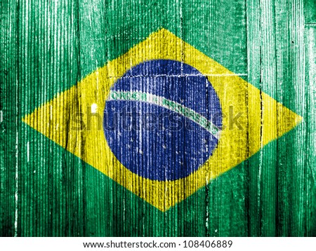The Brazilian flag painted on wooden pad - stock photo