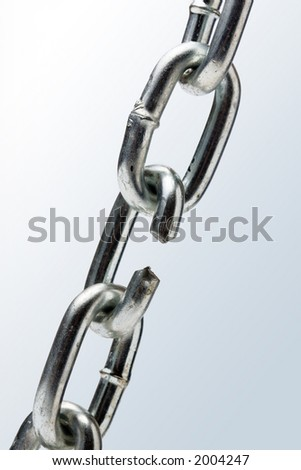 the Breaking Chain on gray - stock photo