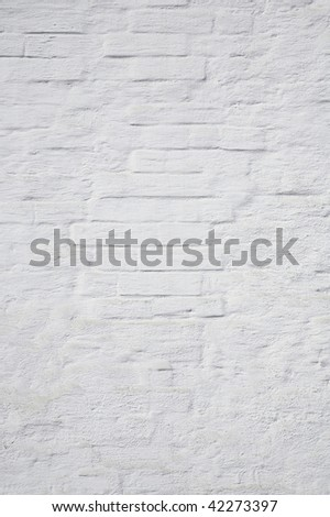 The brick wall painted with a white paint - stock photo