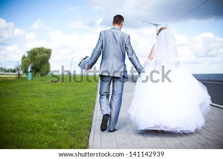 The bride and groom are on the road - stock photo