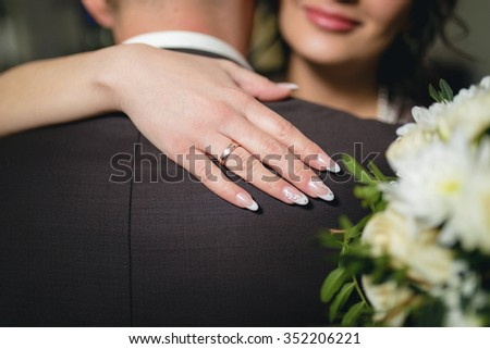 The bride and groom holding a wedding bouquet