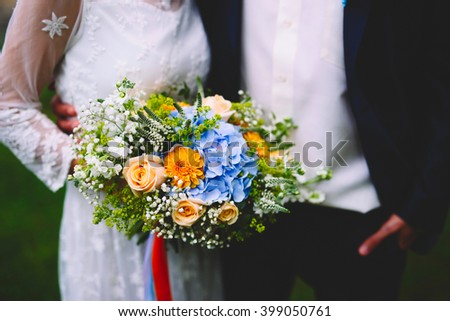 The bride and groom. In the hands of the bride's beautiful bouquet - stock photo