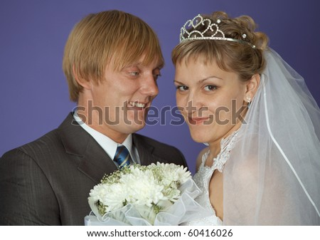 The bride and groom on a purple background closeup - stock photo