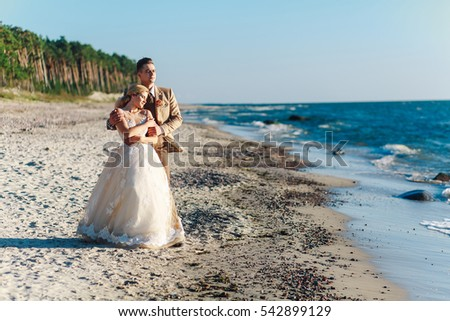 the bride and groom on the beach. Klaipeda, Lithuania