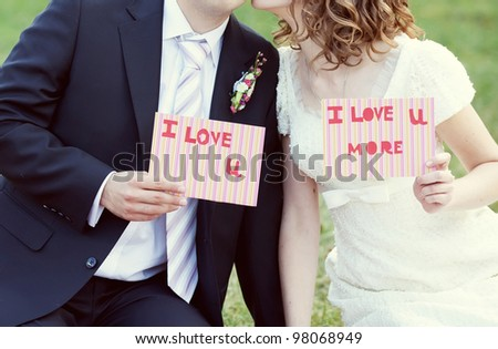 the bride and groom on the nature - stock photo