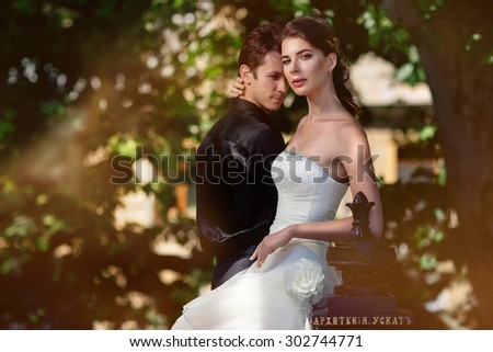 The bride and groom pose for a wedding photo shoot - stock photo