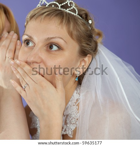 The bride emotionally listens to the latest news - stock photo