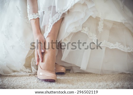 The bride getting her wedding shoes on  - stock photo