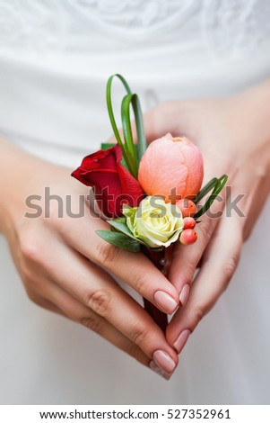 the bride holding a bouquet of groom