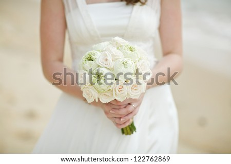 the bride holding the wedding bouquet - stock photo