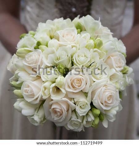 the bride holding wedding bouquet of pink and white  roses - stock photo