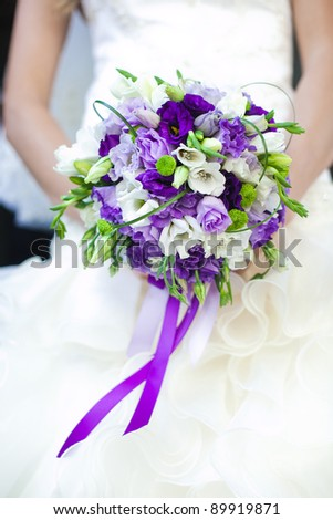 The bride holds the wedding bouquet - stock photo