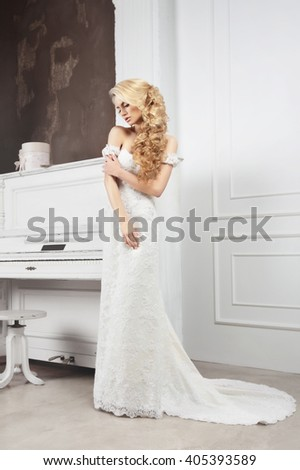 The bride in a white dress in full growth. - stock photo