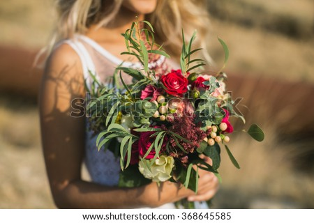 The bride in a white dress with bouquet