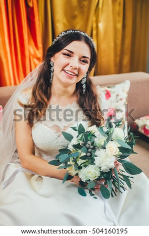 the bride is a brunette, very pretty with a veil. virgin beauty