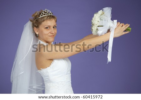 The bride is holding a wedding bouquet - stock photo