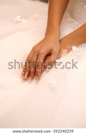 the bride is showing her manicured hands