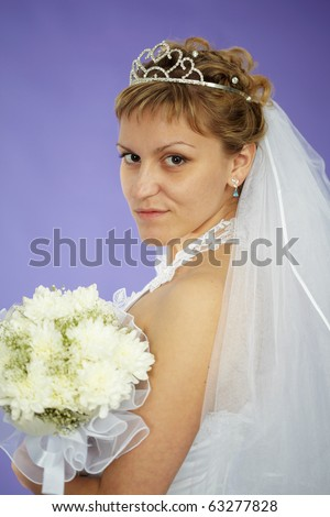 The bride looks at us - a portrait on a purple background - stock photo