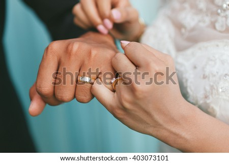 The bride puts a wedding ring on groom's finger,Thailand wedding ceremony