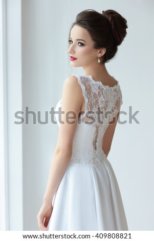 The bride's back in white dress with lace. - stock photo