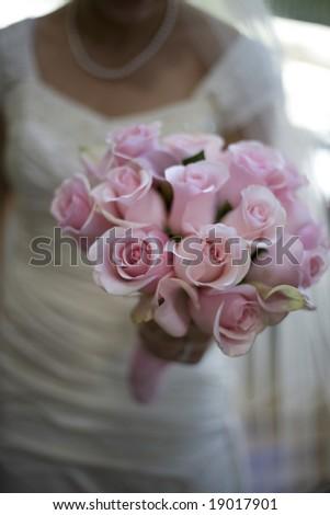 The bride's wedding boquet of pink roses - stock photo