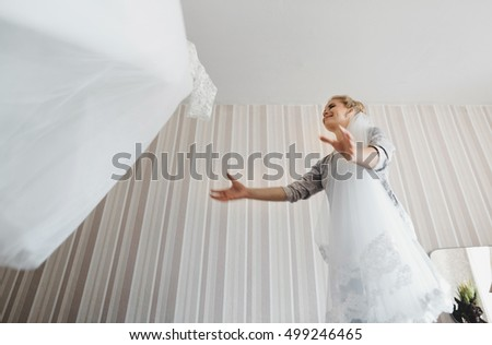 The bride takes a wedding dress