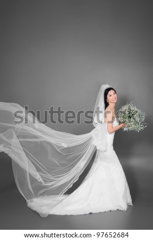 The bride wear marriage dress with flower - stock photo