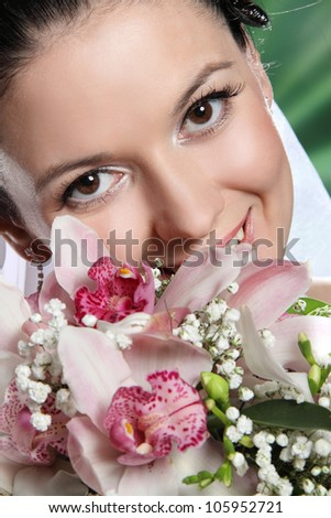 the bride with a big smile and a beautiful bouquet of flowers - stock photo