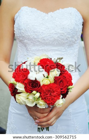 The bride with a bouquet of flowers from roses - stock photo