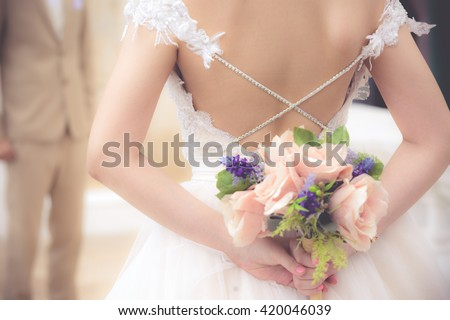 The bride with a bouquet of flowers is a symbol of love is illustrated in a wedding. - stock photo