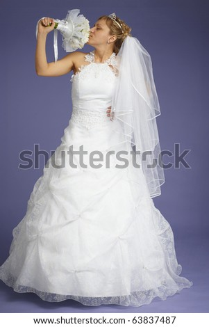 The bride with a bouquet on a blue background - stock photo