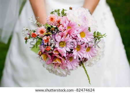 The bride with a wedding bouquet close up outdoor. Shallow deep of field - stock photo