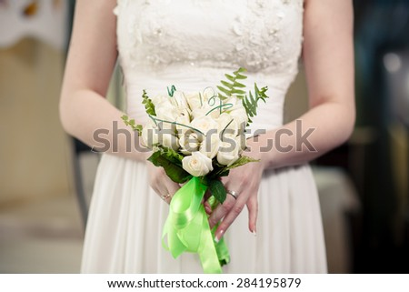The bride with a wedding bouquet white