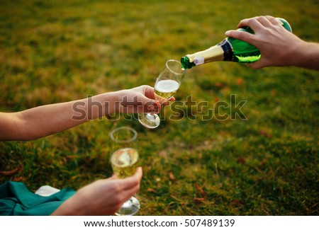 The brides drink a champagne