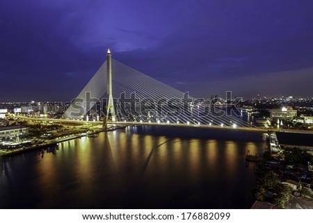 The Bridge across the river at dusk (Bangkok, Thailand) - stock photo