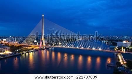 The Bridge across the river at dusk, Rama VIII bridge (Bangkok, Thailand) - stock photo