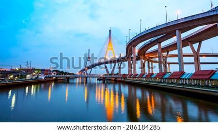 The bridge across the river at night, The industrail ring road (Bangkok, Thailand). - stock photo