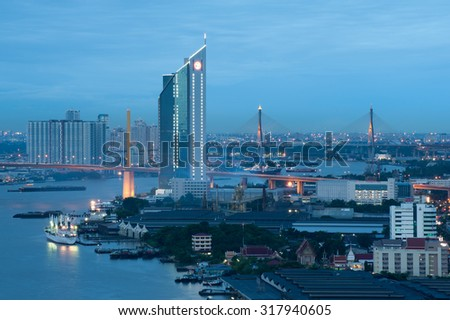 The Bridge across the river with Modern Building at dusk (Bangko - stock photo