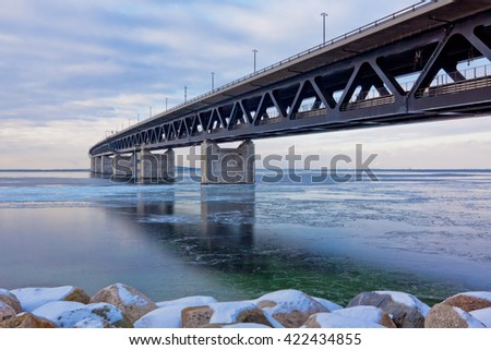 The bridge between Copenhagen Denmark and Malmo Sweden, Oresundsbron, when Winter time and ice on Oresund
