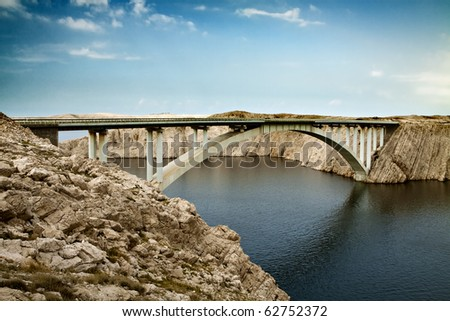 The bridge leading to the island across the sea - stock photo