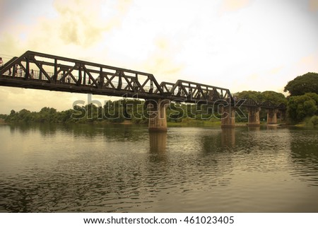 The Bridge of the River Kwai in Kanjanaburi city ,Thailand , use vignetting for focus in center , Change colour to vintage