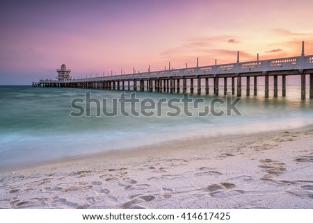 The bridge over the sea with a beautiful sunrise, Rayong, Thailand - stock photo