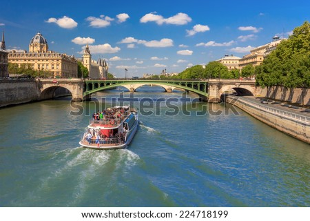 The bridge Pont Notre-Dame over river Seine and the Conciergerie in Paris, France - stock photo