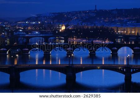 The bridges over the Vltava river in Prague, Czech Republic, at night - stock photo