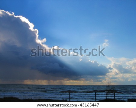 The bright beam of a sunlight has made the way through dense cloud - stock photo