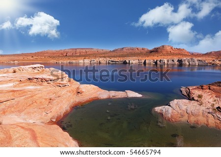 The bright blue water and green bay in the waters of Antelope Canyon in the Navajo Reservation