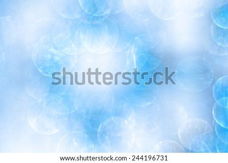 The bright, clear bokeh on blue background - stock photo