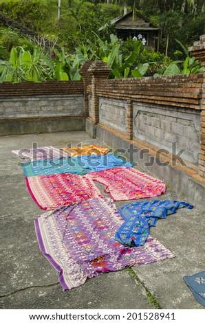 The bright colors of Bali fabrics - stock photo