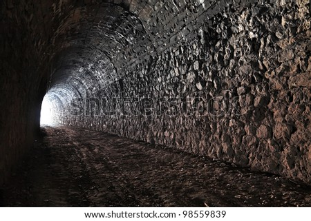 The bright light at the end of the tunnel - stock photo